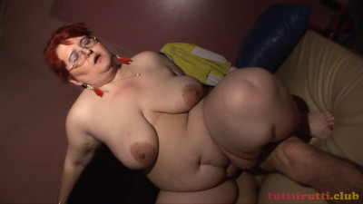 BBW mom in the glory-hole