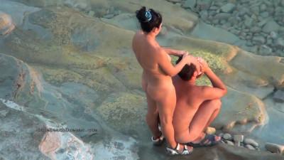 Description Nudist girls expose bodies at the beach