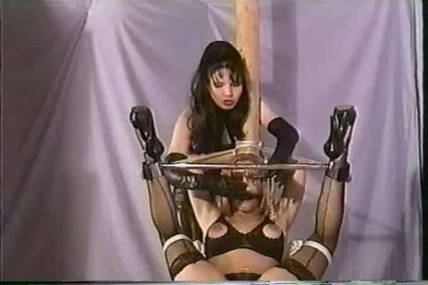 Shes actually bound in rope and her mouth has been covered to prevent screaming