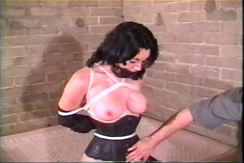 Shes gagged and tied up and the only way out is to try her best to loosen the rope