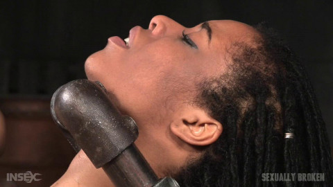 SexuallyBroken - Feb 12, 2016 -  Toned Kira Noir restrained in metal pipes and belt bondage