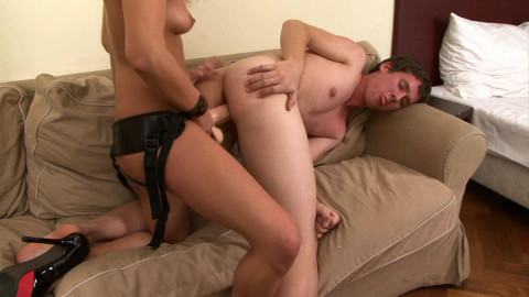 Redhead drills her boyriends asshole with strap on