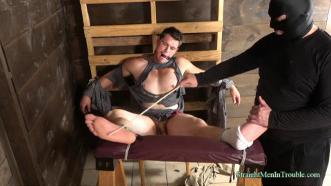 With his feet bound to the spanking