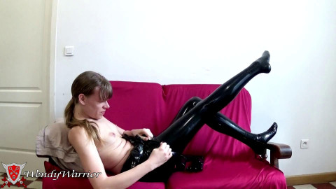 Wendy warrior in latex in enormous chastity play strap