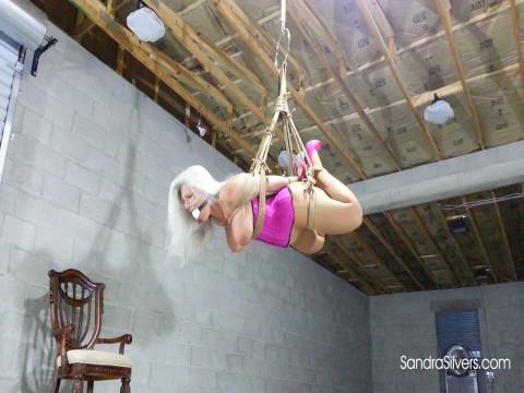 Buxom Dangling Damsel Suspended In Open Leg Hogtie as Naked Mistress Orgasms