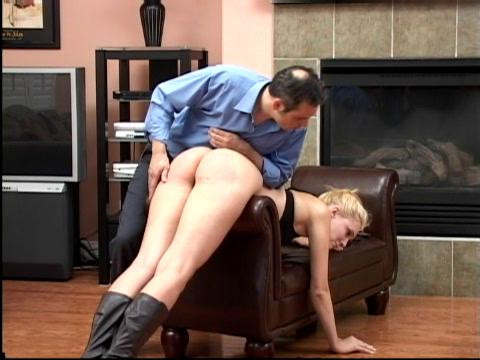 Then she is stripped to her seductive black lingerie and spanked again