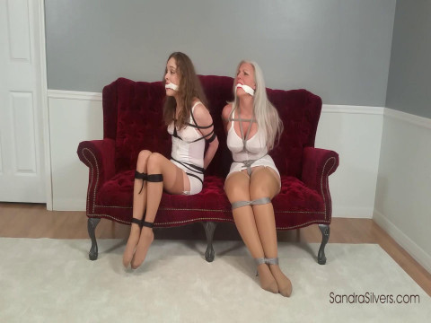 Classic Damsel-in-distress as Two Girdle-Bound Roommates Attempt Escape
