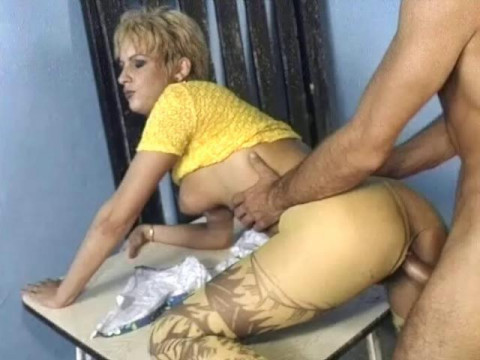 Fucking a girl on the table