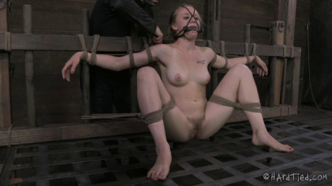 Her bondage adventure begins with a simple hog-tie and evolves