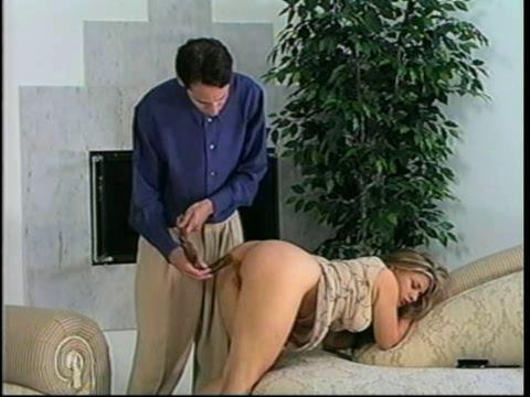 Depicts traditional over the knee spanking