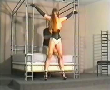 She struggles to get out and escape the tight rope around her