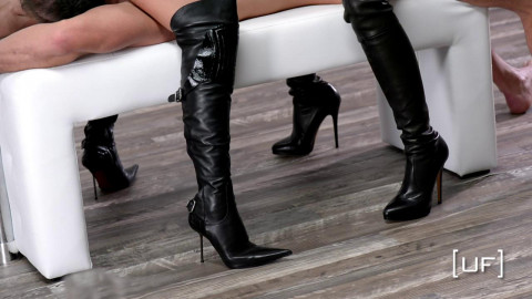 Two strippers drochat guy on his boots