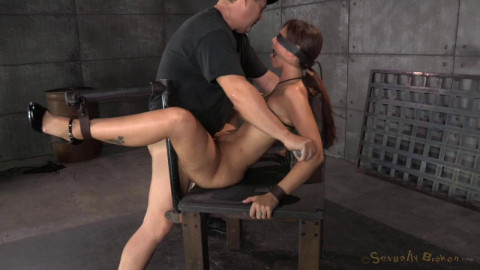 Busty blindfolded Syren De Mer restrained in strict device bondage