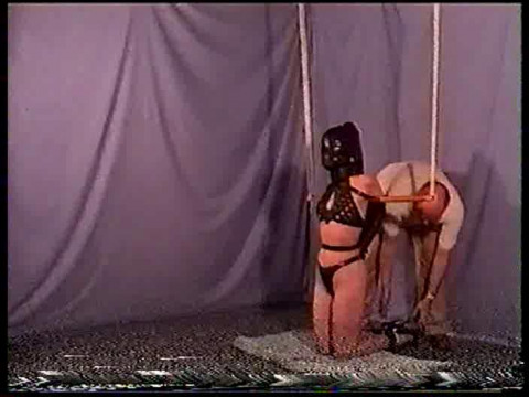 Shes tied with rope and you can see her move around