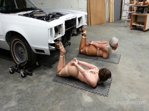 Two Ballgagged & Drooling, Pantyhosed MILFs Hogtied in the Auto Shop!