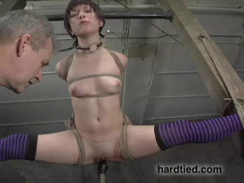 Bound in a reverse hogtie, her body arched upward
