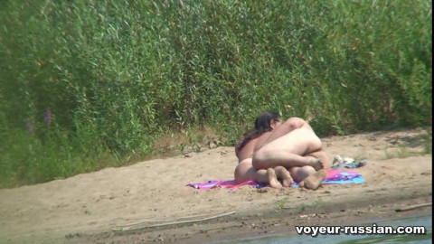 The Russian couple somersaults on the desert beach