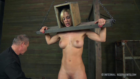 The chains he has her shackled in should give her a hint of what is to come