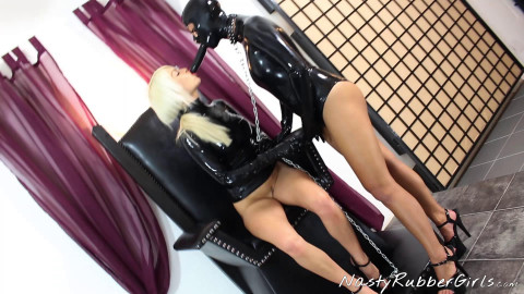 Rubber mistress and slave mask dressing strap-on part two (2017)