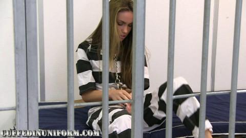 Sylvie neck cuffed in prison