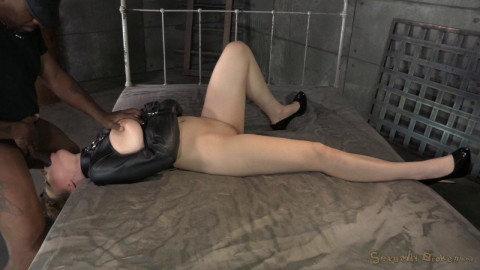 Jessica Ryan bound in a straightjacket