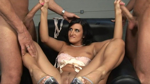 Slutty bitch jerks of two cocks and gets facial