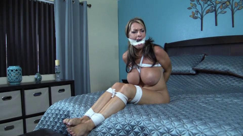 Hogtied with my mouth stuffed and taped on the floor