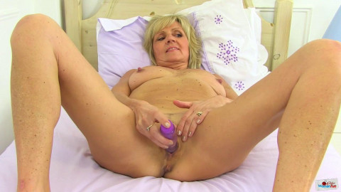 Slim mature dolly playing with purple dildo