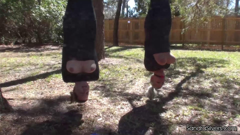 Double strappado on the outdoor for two girls