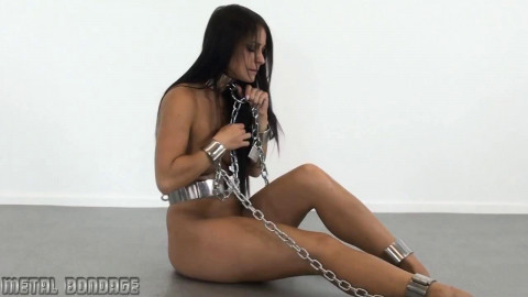 Melissa in enormous metal and chains