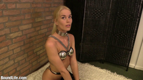 Nipple clamps beneath enforced chastity brassiere