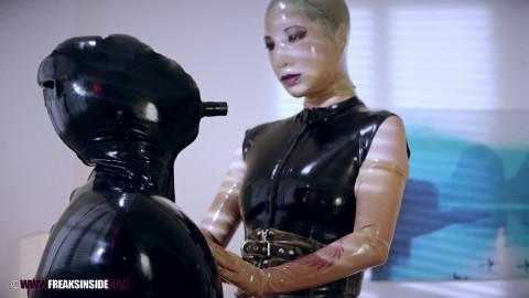 Black rubber submissive