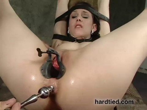 A bondage slut that loves being choked, she struggles through some rough positions
