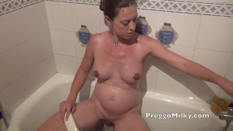 Pregnant masturbation in the bath