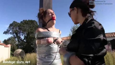 Bondage, encasement and pain for undressed gal