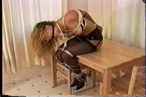 Her screams and squels can hardly be heard because shes double gagged