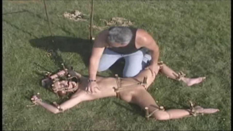 Hard bondage, domination and torment for naked bitch on the outdoor