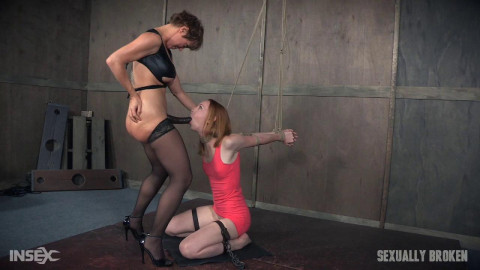 Katy Kiss the sexy tall redhead, is severely bound, deepthroated and brutally fucked into darkness