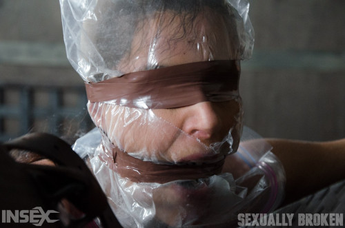 bdsm Milf tied up with stockings mask and tape gag