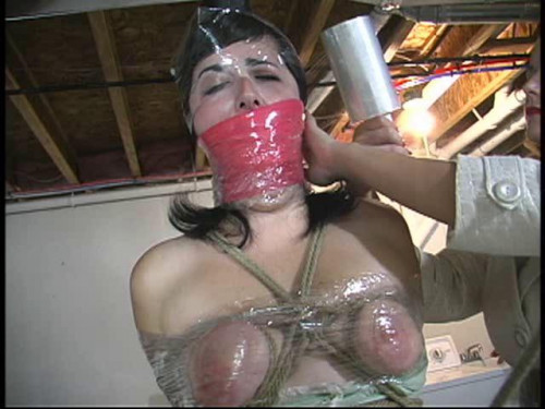 BDSM Dixie gets tied to the pole