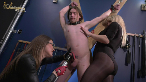Femdom and Strapon Tormented on the Cross