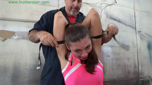 BDSM Hunterslair - Ren Smolder - Handcuffs, chains and leather straps hold her captive