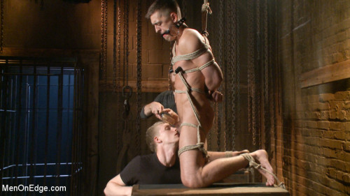 Gay BDSM Party boy wakes up to find himself in a crucified edging