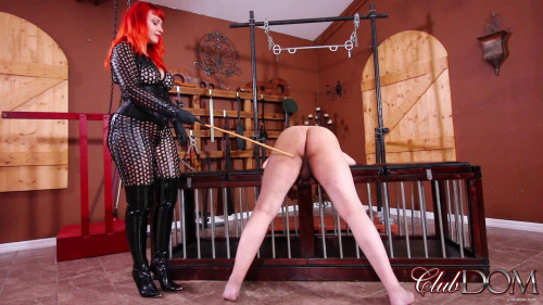 Femdom and Strapon Her new latex catusuit