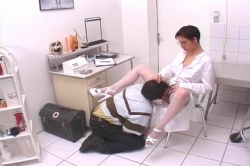 Femdom and Strapon On The Floor Slave