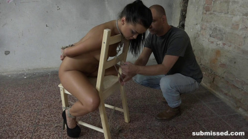 BDSM Sexy brunette chair bound and whipped