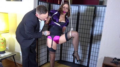BDSM Karly is let down from her doorway