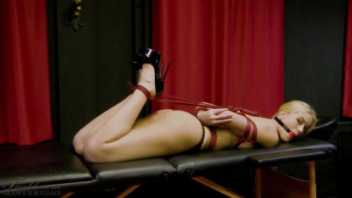BDSM Sophie hogtied and gagged on the massage table