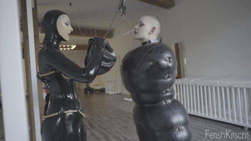 BDSM Latex Finds herself strung up like