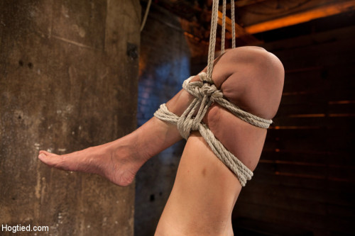 BDSM Tiny flexible brunette suffers a Category 5 suspension while being made to cum over and over!